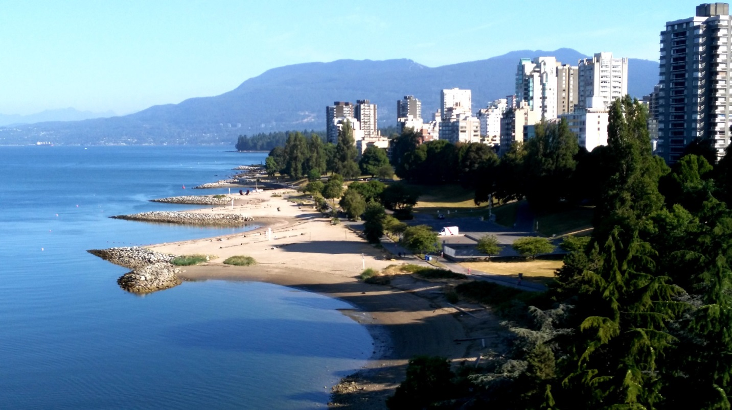 Figure 17.30 Photograph of the impact of breakwaters on beach development at Sunset Beach, Vancouver [by Isaac Earle, used with permission]