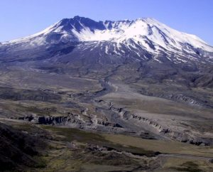 Figure 4.11 The north side of Mt. St. Helens in southwestern Washington State, 2003 [SE photo]. The large 1980 eruption reduced the height of the volcano by 400 m, and a sector collapse removed a large part of the northern flank. Between 1980 and 1986 the slow eruption of more mafic and less viscous lava led to construction of a dome inside the crater.