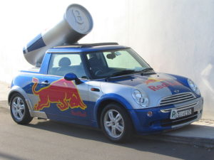 A car with the Redbull logo sprinted on the side