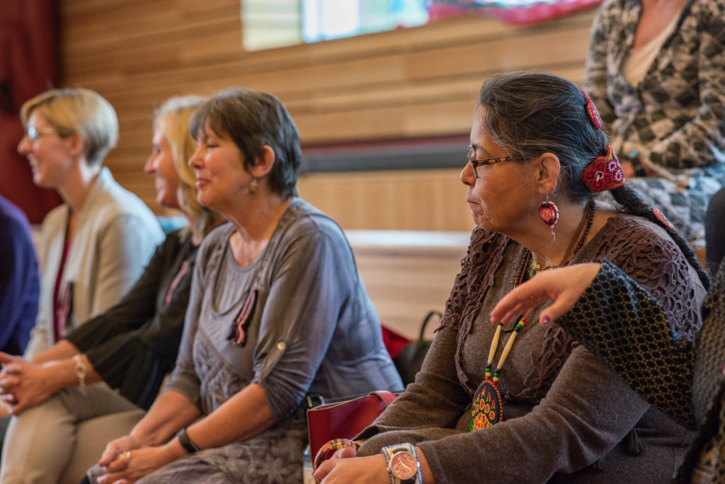 People seated participating in the Metis Nation \-BC join project announcement
