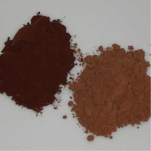 Two piles of cocoa powder. The dutch process cocoa is much darker brown than the natural process cocoa.