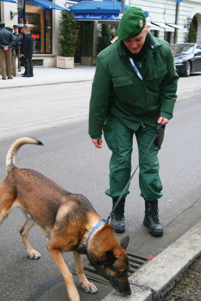 Police officer with a sniffer dog.