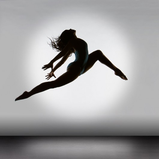 A dancer leaps into the air