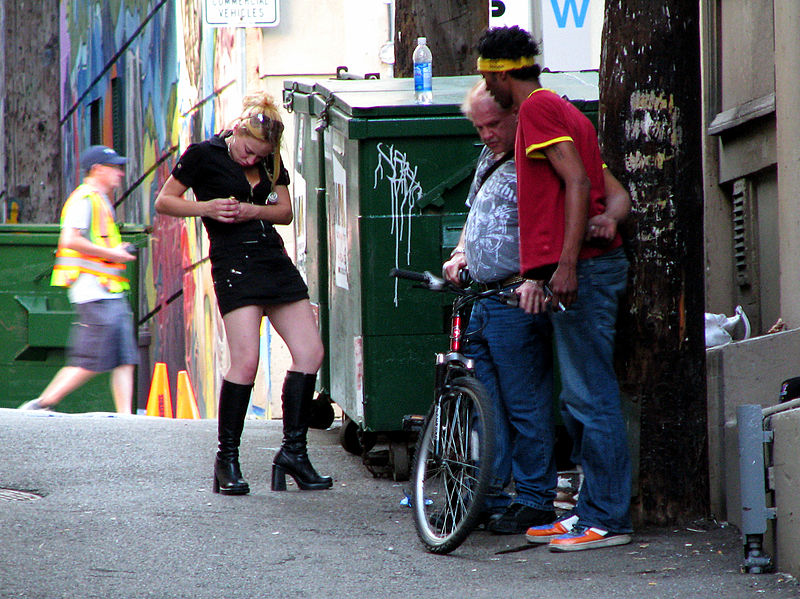 Three drug addicts seen smoking a huge amount of crack cocaine, in a downtown eastside alley, in Vancouver BC Canada