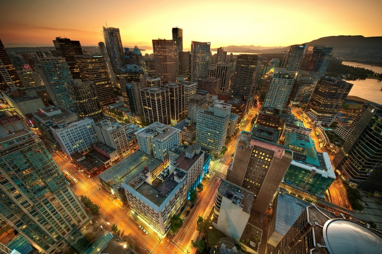 The Vancouver skyline at night is shown here.