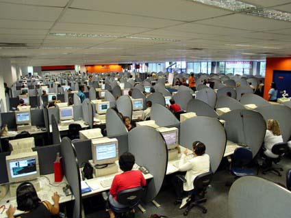 Many People At Workstations In A Call Center Are Shown Here