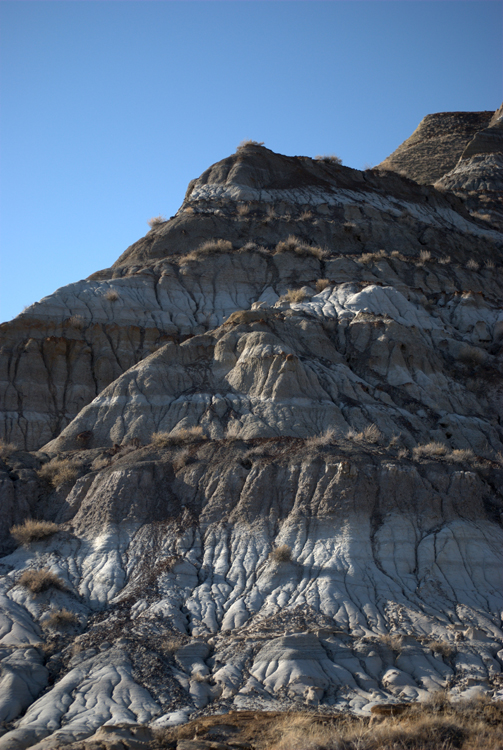 A rock formation showing various layers is shown.