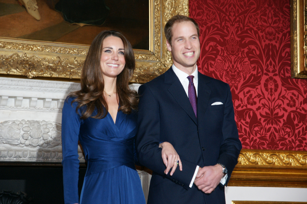 Prince William is shown holding wife Catherine Middleton's hand.