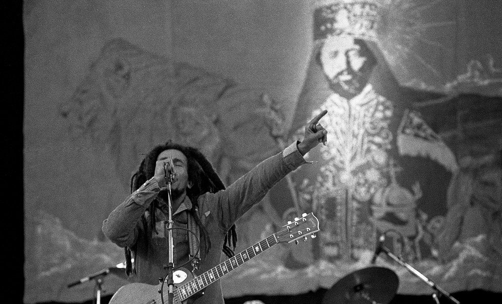 Bob Marley on stage speaking into a microphone