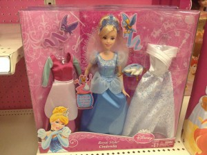 A Cinderella doll with a dress for cleaning, a ball gown, and a wedding dress.