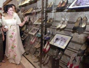 Imelda Marcos' shoes in a glass display case.