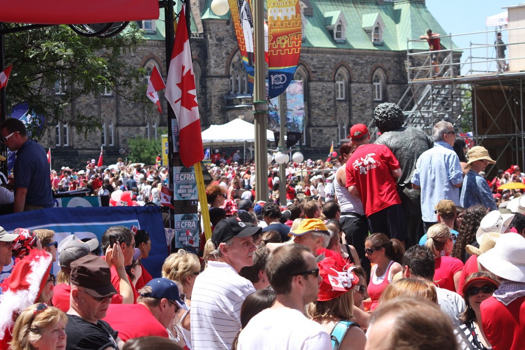 A crowd of people celebrating Canada day