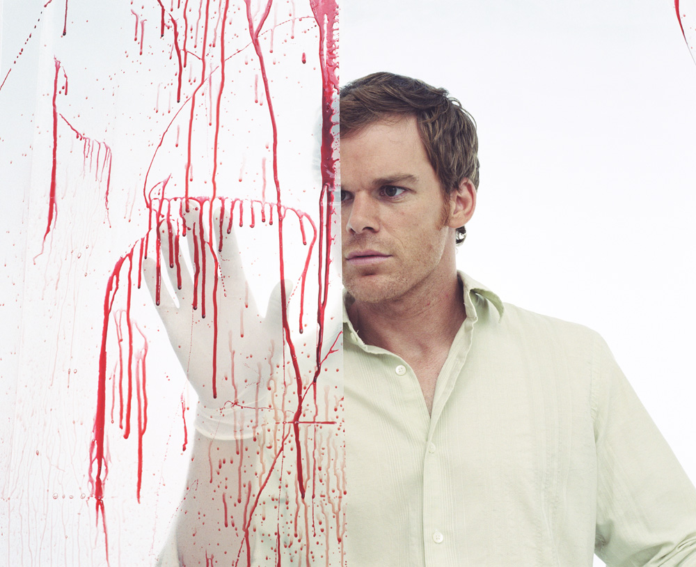 The TV character Dexter, looking at blood splatter on a wall.