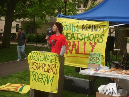 A protester giving a speech protesting sweatshops.