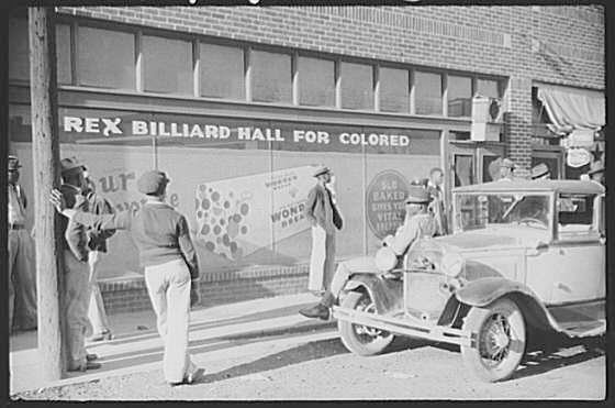 """The store front of a billiard hall called, """"Rex Billiard Hall for Colored"""""""