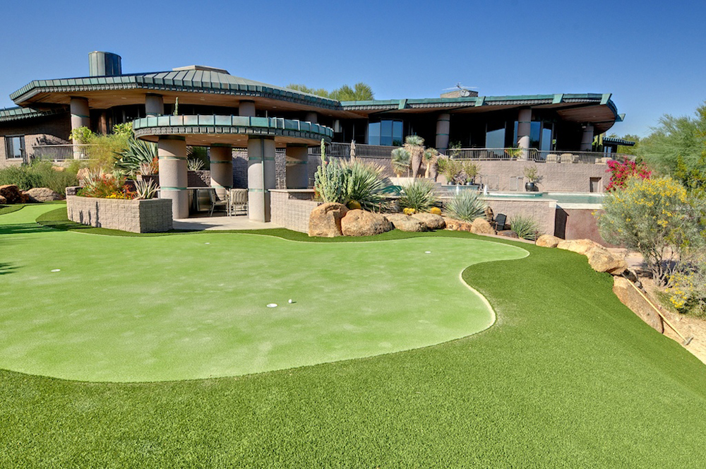 A luxurious house with a golf course.