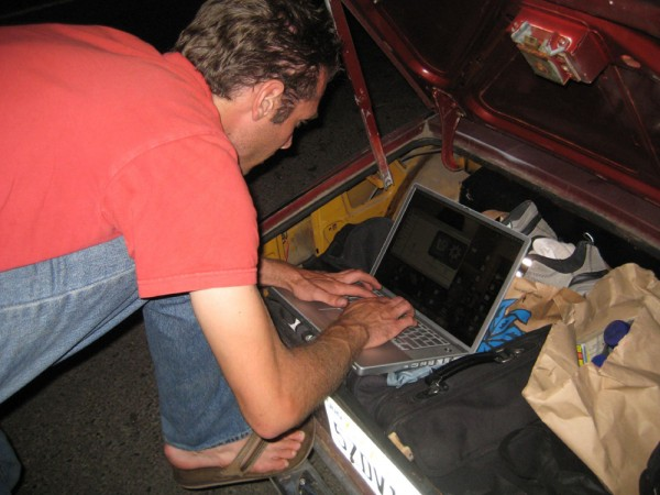 A man typing on his laptop.