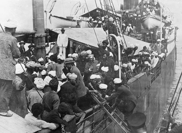People board an already crowded ship.