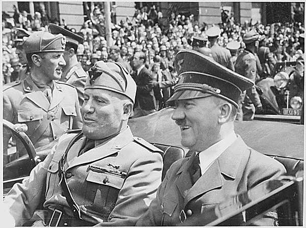 Adolf Hitler and Benito Mussolini riding in a car together.