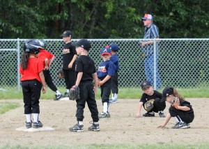 Young children playing baseball
