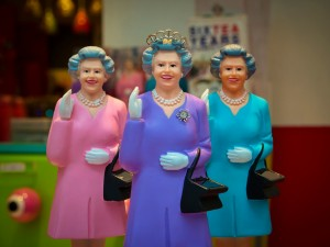 Three toy replicas of Queen Elizabeth II.