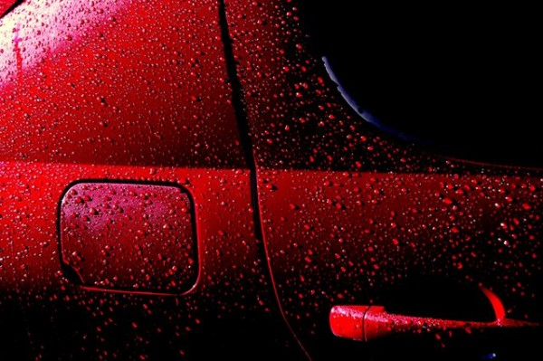"Droplets of water on a freshly waxed car do not wet the car well because of low adhesion between water and the waxed surface. This helps protect the car from rust. ""Wet Red Car 1′′ by Rob Innes is licensed under the Creative Commons Attribution-NonCommercial-NoDerivs 2.0 Generic."