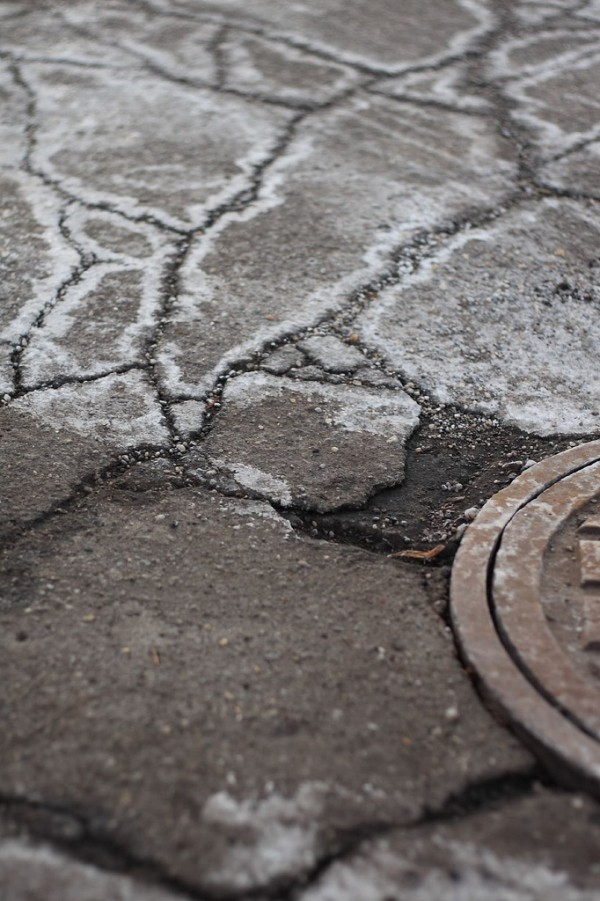 "Salt or other compounds take advantage of the freezing point depression to minimize the formation of ice on sidewalks and roads, thus increasing safety. Source: ""Salt, road, and cover"" by Phil Romans is licensed under the Creative Commons Attribution-NonCommercial-NoDerivs 2.0 Generic."