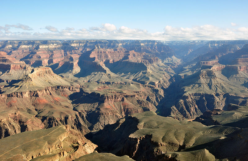 "The Grand Canyon was formed by water running through rock for billions of years, very slowly dissolving it. Note the Colorado River is still present in the lower part of the photo. ""Grand canyon yavapal point 2010′′ by chensiyuan is licensed under Creative Commons"