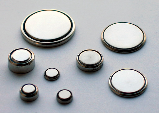 "Button batteries like those seen here can be used for a variety of portable electronics, from watches and hearing aids to handheld gaming devices. Source: ""Coin Cells"" by Gerhard H Wrodnigg is licensed under the Creative Commons Attribution-Share Alike 2.5 Generic license."