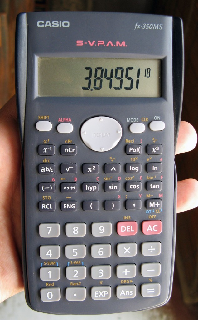 "This calculator shows only the coefficient and the power of 10 to represent the number in scientific notation. Thus, the number being displayed is 3.84951 × 1018, or 3,849,510,000,000,000,000. Source: ""Casio""Asim Bijarani is licensed under Creative Commons Attribution 2.0 Generic"