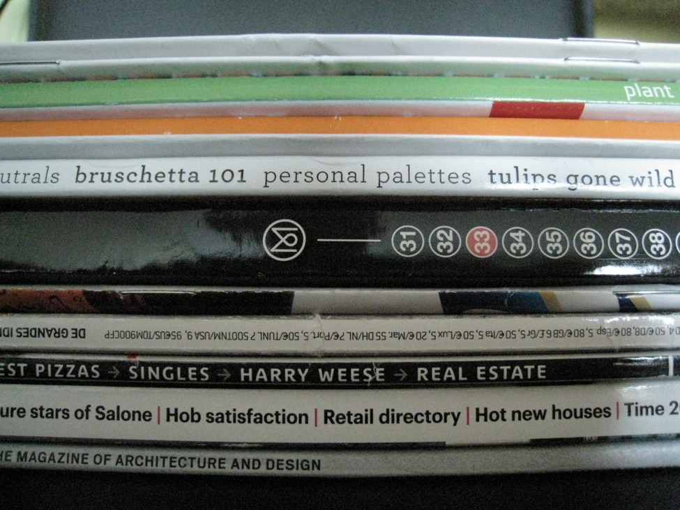 This is a photo of magazine spines. The magazines cover various topics like plants, food, and architecture.