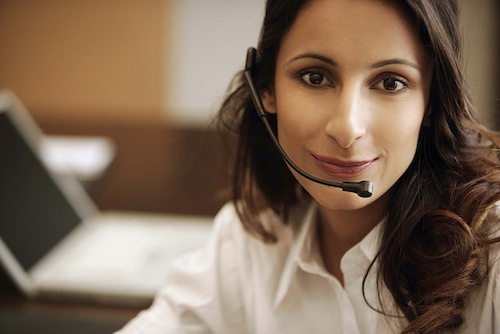 A woman wearing a phone headset.
