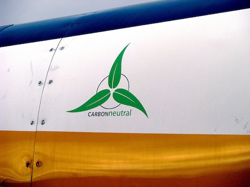 "A symbol saying ""carbon neutral"" on the side of a sea plane."