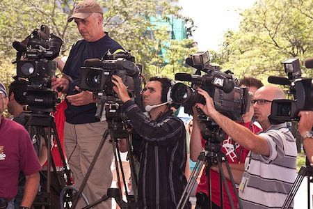 A number of news reporters with their video cameras.