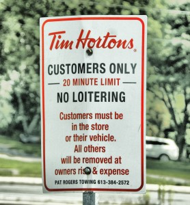 Tim Horton's parking sign. Long description available.