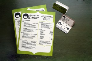 A stylized set of resumes and business cards with a green border.