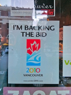"A sign posted on a pub's window reads, ""I'm backing the bid. 2010 Vancouver."""