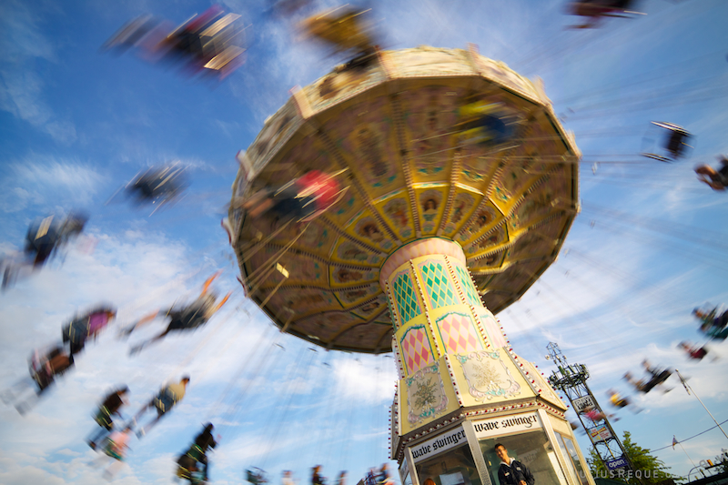 An amusement park ride that is like a carousel with swings, whirling people through the air.