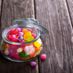 A jar of jelly beans sitting on a table