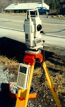 Photo of a Total station next to a road