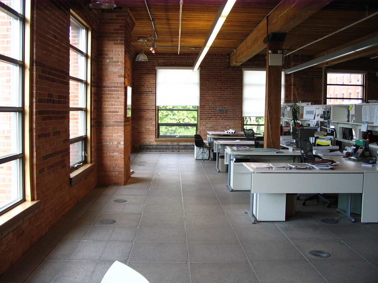 A photo shows a view of an open office.