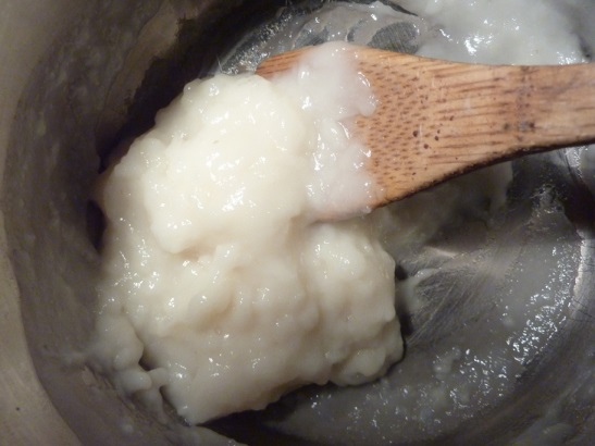 Thick, white goop in a pot.