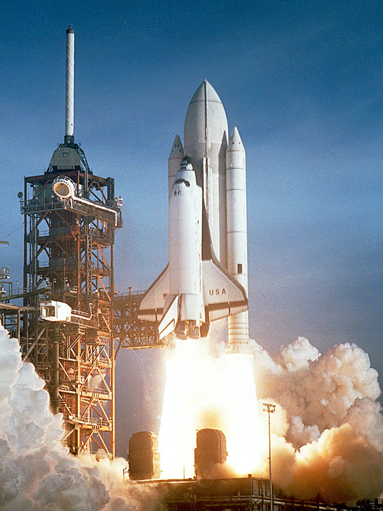 The space shuttle is launched. It consists of the shuttle orbiter, two solid rocket boosters, and an expendable external tank. It takes off leaving much smoke and fire.