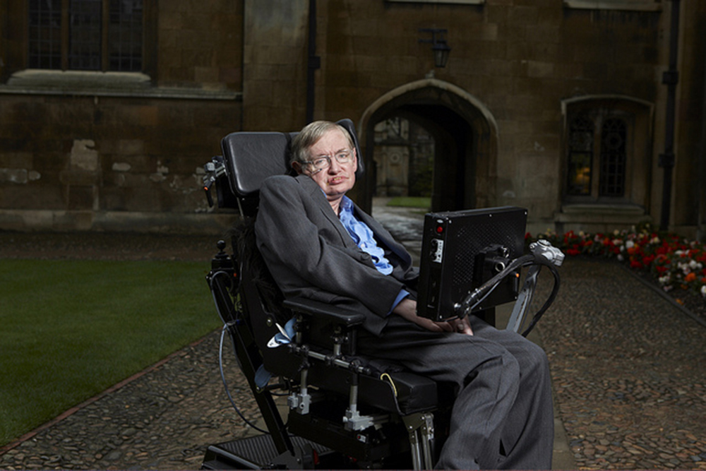 A photo of Stephen Hawking sitting on his special chair fitted with modern gadgets.
