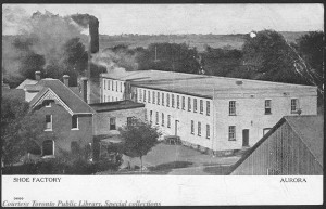 As late as 1910 the boundary between rural life and industrial employment was not a great one. The countryside forms a backdrop to a shoe factory in Aurora, Ontario, ca. 1910. Postcards like this one were a way of framing modernization and material progress. (Toronto Public Library) https://www.flickr.com/photos/43021516@N06/5436281688