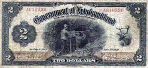 The 1920 Newfoundland $2 bill features iron ore miners (presumably on Belle Isle) and a caribou, but no prominent politicians or royalty. https://en.wikipedia.org/wiki/Newfoundland_dollar#/media/File:NFLD_2_dollar.png