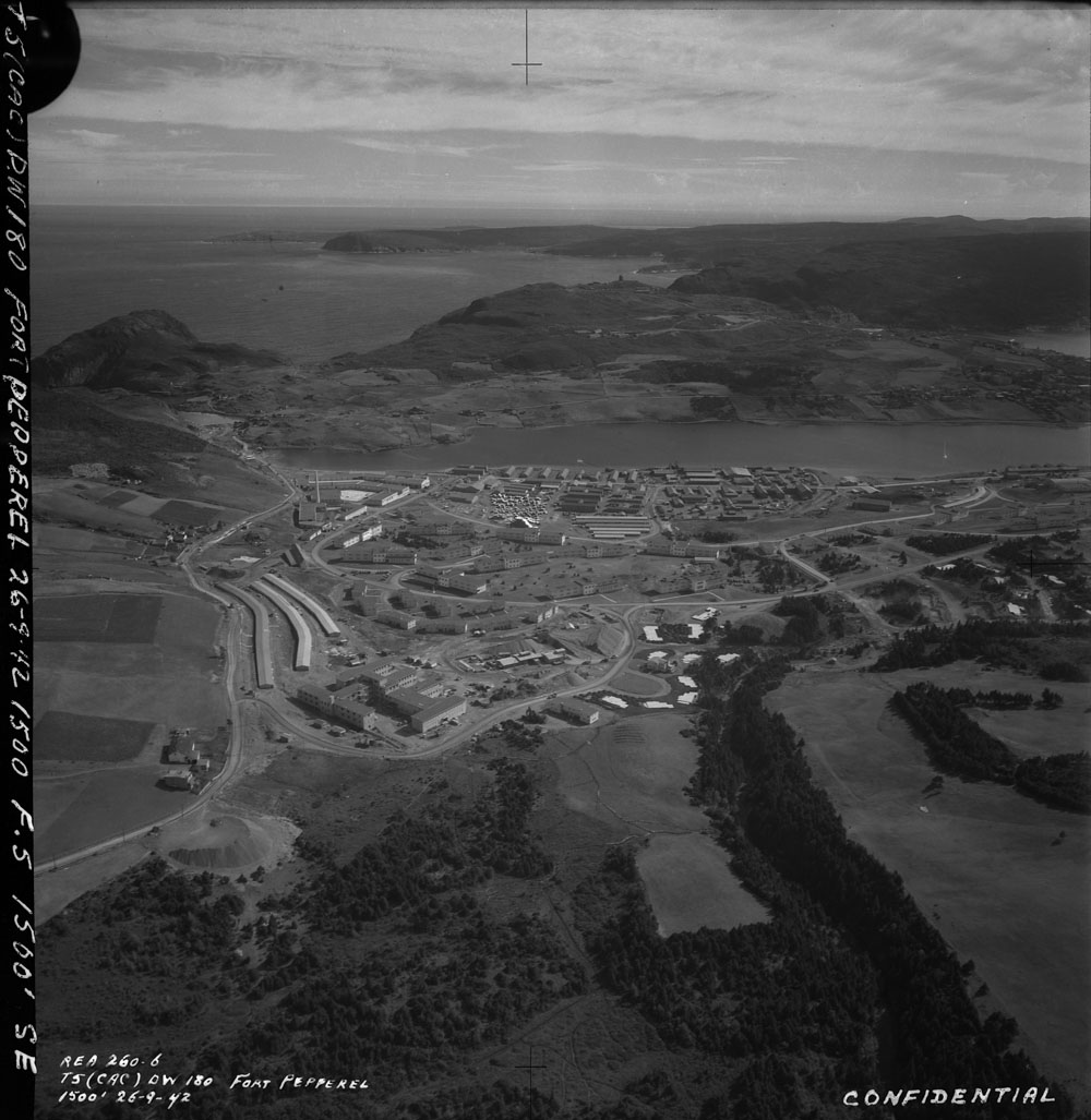 Aerial view of an air force base, with barracks and various buildings.