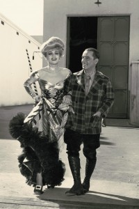 """Robert W. Service (seen here in 1941 with screen star Marlene Dietrich) struck gold with poetry. Service reads of his best known poems, """"The Cremation of Sam McGee"""" here. https://commons.wikimedia.org/wiki/File:Robert_Service_during_the_%22Spoiler%22_with_Marlene_Dietrich.jpg"""