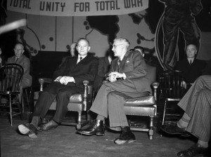 Tim Buck (left, seated) returns to Maple Leaf Gardens in 1942. (City of Toronto Archives, Fonds 1257, Series 1057, Item 7099.)