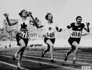 Myrtle Cook crosses the line first in a 100 m heat at the 1928 Olympics.